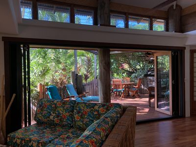 Living Room with View to Outdoor Lanai and Garden