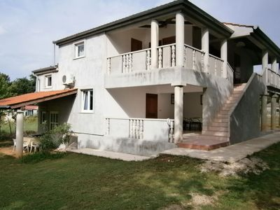 Photo for Apartment in holiday home with pool, spacious garden with grill, airco and wifi