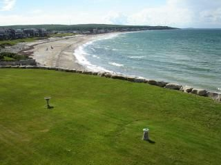 Manicured Lawn with beach below at high tide ...