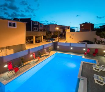 Photo for 418 m from the center of Podstrana with Internet, Pool, Air conditioning, Parking (740149)