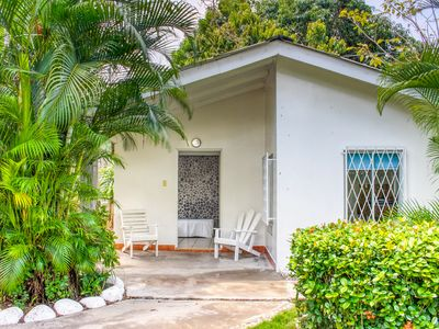 Photo for Colorful getaway w/ shared pool/gardens & a great beachfront location!