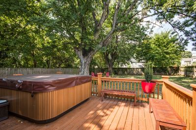 Yes, you can relax in the backyard w/HOT TUB only 2 miles from all the action!