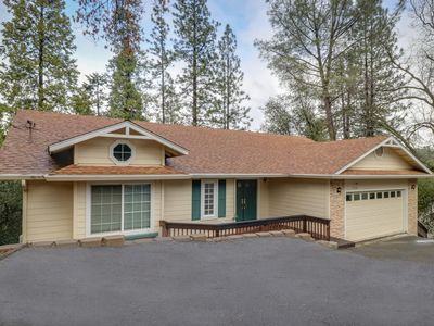 Photo for Serene, central woodland home w/ deck, Ping-Pong & shared pool/tennis!