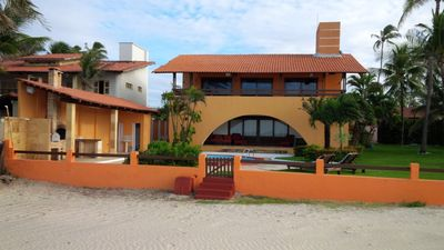 Photo for Beach house with swimming pool, terrace and walk in the sand.