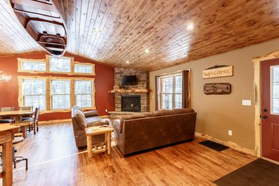 Beautiful knotty alder ceiling gives the living room a warm cabin feel.