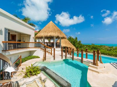 Photo for Turtle Breeze, a One-of-a-Kind Architectural Masterpiece on Grace Bay Beach