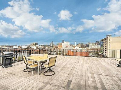 Photo for Elegant condo w/ gorgeous roof deck - blocks to the T, seaport & South Boston!