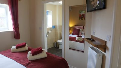 Superb bedroom with comfortable king-size bed and luxury en-suite shower room