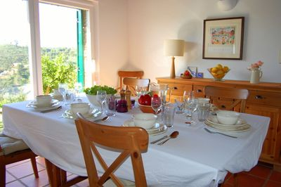 Dining space for 6 to 8 people with views of the valley down to the lake.