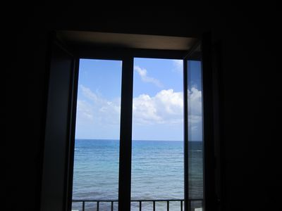 Photo for Azzurro Whole sea apartment overlooking the sea on the walls of Tramontana