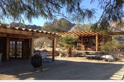 Spectacular views of desert below, but only five minutes from El Paseo shopping!