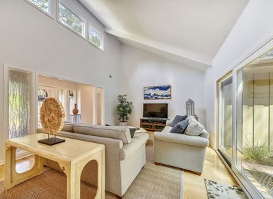 Formal Living Room with TV and Pool Deck Access at 10 Battery Road