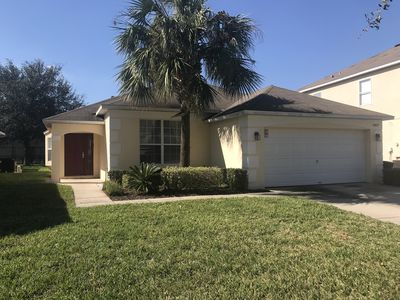 Photo for Luxury 4 Bedrooms with Pool heated at 88°, 3 miles from Disney!