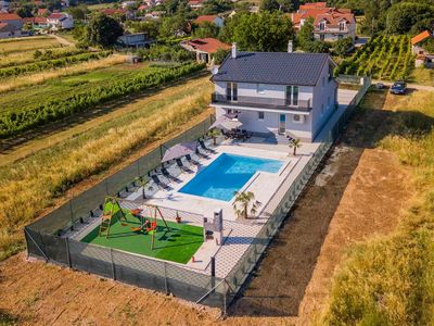 Photo for Villa with swimming pool, terrace and children's playground