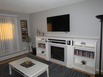 "Living Room with Built in Fireplace,Book Shelf and 55"" Smart Samsung TV"