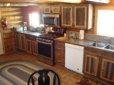 The fully equipped kitchen has a stainless gas stove & all you need for cooking.
