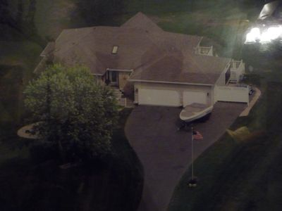 Ariel View...Property is on a 1.2 acre lot with 117 feet of frontage on the Lake