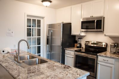 Kitchen - Beautifully remodeled kitchen with granite counters and state of the art appliances.