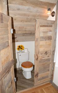The toilet area in the main level bedroom