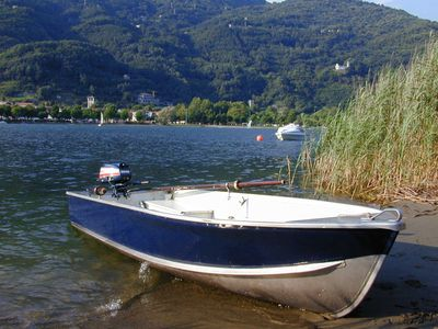 Photo for » near by sandy beach  » Holiday near the lake » enjoy a large garden » with a family rowing/fishing boat, available on request