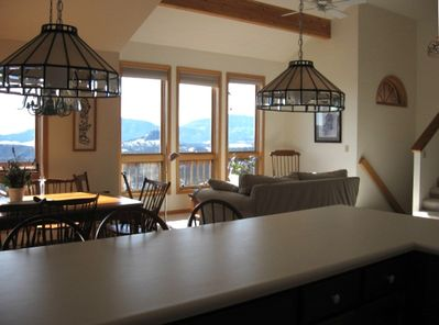 Kitchen, Dining and LR looking out over deck and mountains