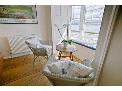 Photo for A Georgian seaside cottage that sleeps 8 and welcomes dogs. Stunning sea views.