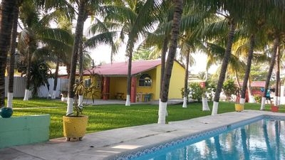 Photo for Ocean side retreat with great swimming pool, in pool table, palm trees,