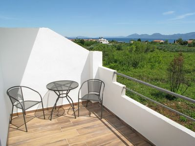 Balcony with table & chairs