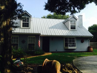 Photo for Pet-friendly, lovely home with large inground pool, live oaks and fenced yard.