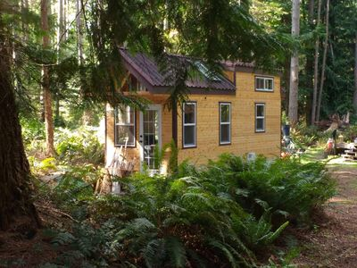 Photo for Beautiful Tiny House on wheels on treed lot, minutes from beaches, bikes incl