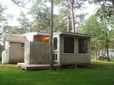 Screened porch, deck w large outdoor shower, gas grill or charcoal grill, outdoor seating, kids bikes