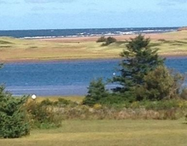 Beach and ocean view from the cottage deck. This is your actual view!!!