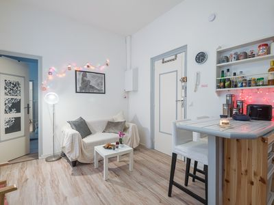 Photo for Charming apartment on the pedestrian street of the