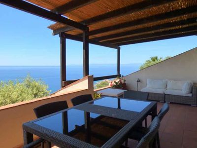 Photo for Splendid Villa with breathtaking views a stone's throw from the beach