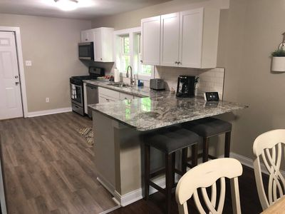 Kitchen, 2-seater bar, stove, oven, microwave, toaster, coffee maker