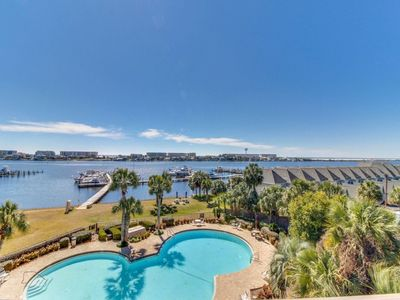 Photo for NEW! Waterfront condo w/ pool, marina & boat slip!