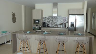 Photo for Brand new 3-bedroom condo with ocean view located on Eagle Beach