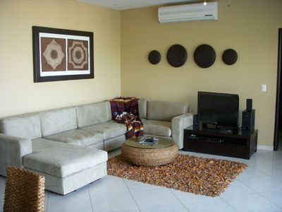 Comfortable living room with TV and sweeping views of Banderas Bay