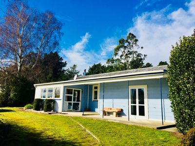 Photo for Relaxing cosy 1950's family beach house 1 block back from the beautiful beach.