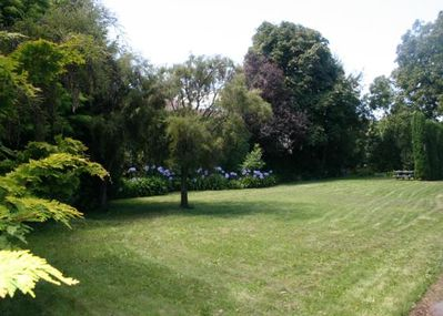 View from rear garden and tennis court