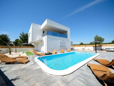 Photo for Modern villa near Vodice, with private swimming pool and the beach just 100 m away!