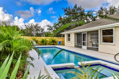 The private backyard has a lap pool & chaise lounges for relaxing in the sun.