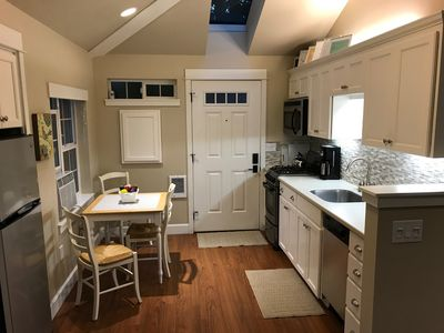 Kitchen has 4 burner gas stove and oven, microwave, dishwasher, and refrigerator