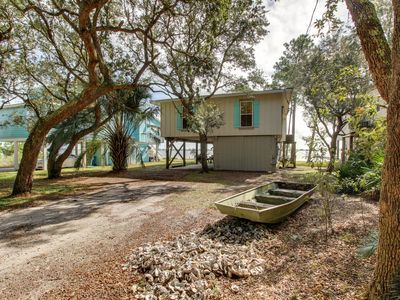 Photo for Lagoon-front home w/tiki bar & dock/boat lift-near beach