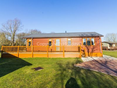 Photo for Stunning  luxury lodge in with a FULL lake view and decking in Suffolk ref 60002