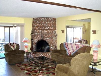Living Room with beehive wood burning fireplace.