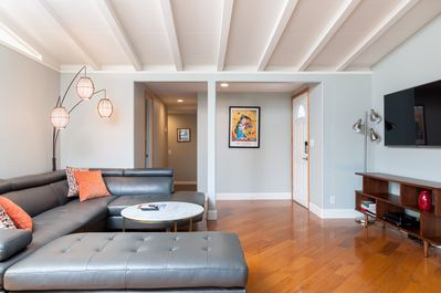 Open, spacious living room that allows everyone to hang out together. Perfect fo