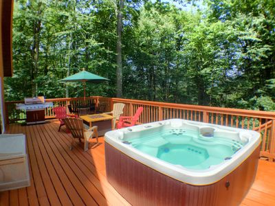 BRAND NEW! Private back deck with dining table, chairs, BBQ grill and hot tub.