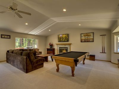 Living room has an Olhausen pool table, cozy fireplace, and a great home entertainment system