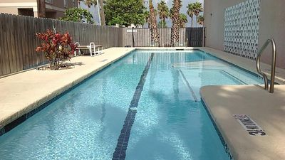 Photo for Vacation rental condominium. Sleeps 4. Half block to bay, close to entertainment district and share